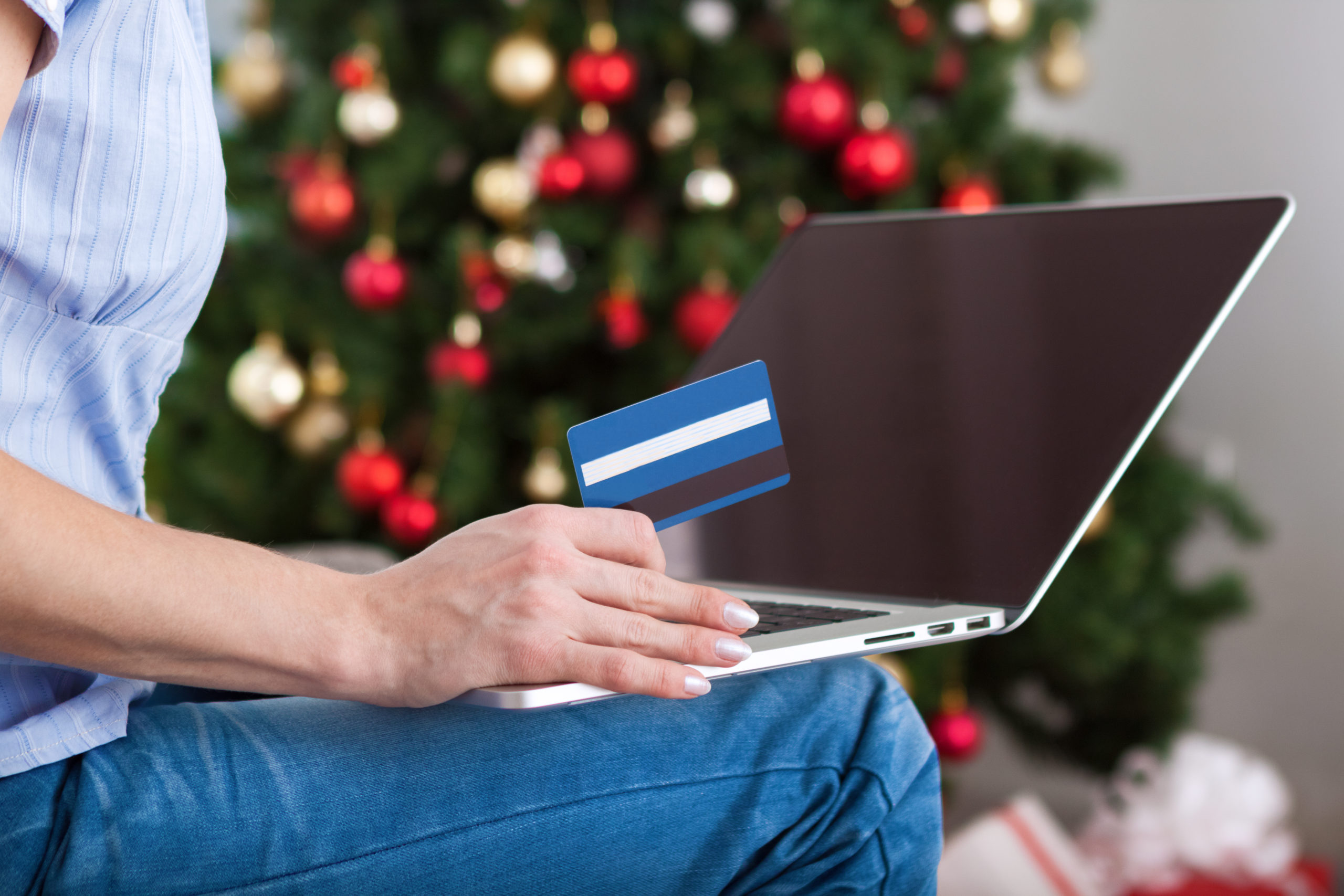 Woman shopping online with credit card for christmas