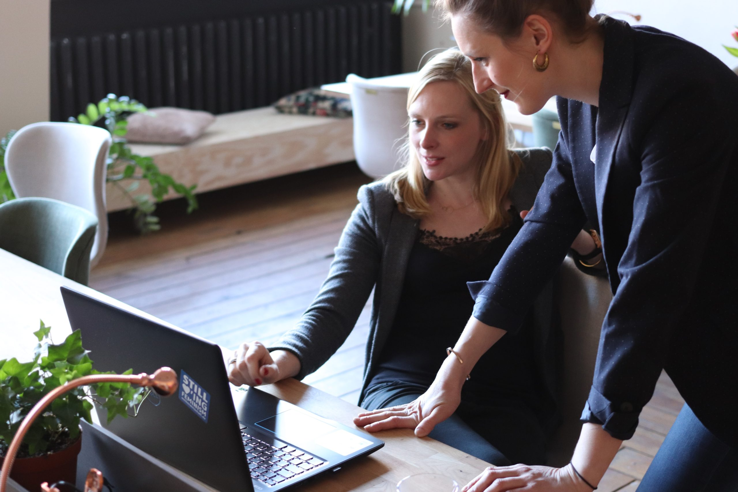Two people in front of a laptop